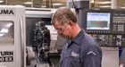 Experienced machinist runs a live tool lathe